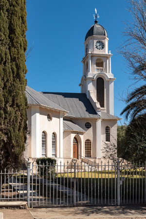 PETRUSVILLE, SOUTH AFRICA, AUGUST 6, 2018: A street scene, with the Dutch Reformed Church, in Petrusville in the Northern Cape Province