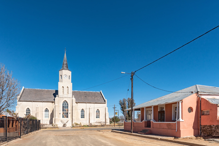 PHILLIPSTOWN, SOUTH AFRICA, AUGUST 6, 2018: A street scene, with the Dutch reformed Church and historic houses, in Phillipstown in the Northern Cape Province