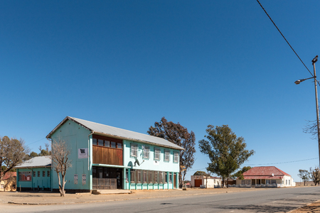 PHILLIPSTOWN, SOUTH AFRICA, AUGUST 6, 2018: A street scene, with an office building and house, in Phillipstown in the Northern Cape Province