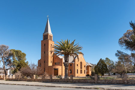 DE AAR, SOUTH AFRICA, AUGUST 6, 2018: A street scene, with the Reformed Church, in De Aar in the Northern Cape Province