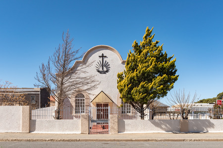 DE AAR, SOUTH AFRICA, AUGUST 6, 2018: A street scene, with the Old Apostolic Church, in De Aar in the Northern Cape Province