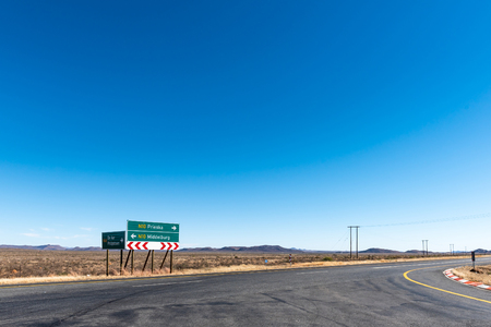 Directional signs at the conjunction of the N10 and R48 roads at De Aar in the Northern Cape Province