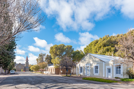 LOXTON, SOUTH AFRICA, AUGUST 7, 2018: A street scene, with historic houses and the Dutch Reformed Church, in Loxton in the Northern Cape Province