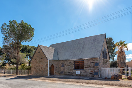 FRASERBURG, SOUTH AFRICA, AUGUST 7, 2018: A street scene, with the Afrikaans Protestant Church, in Fraserburg in the Northern Cape. Trees are visible