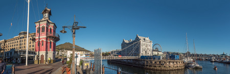 CAPE TOWN, SOUTH AFRICA, AUGUST 9, 2018: Panotamic view of the Clock tower, swing bridge, and historic Port Captains building at the Victoria and Alfred Waterfront in Cape Town in the Western Cape Province