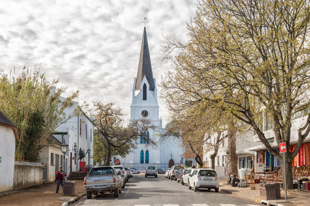 STELLENBOSCH, SOUTH AFRICA, AUGUST 15, 2018: Church Street with the historic Dutch Reformed Mother Church in Stellenbosch in the Western Cape Province. Vehicles and people are visible Editorial