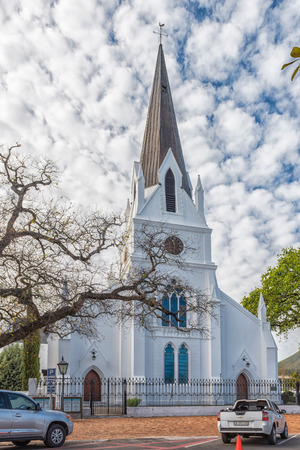 STELLENBOSCH, SOUTH AFRICA, AUGUST 15, 2018: The historic Dutch Reformed Mother Church in Stellenbosch in the Western Cape Province. Vehicles are visible Editorial