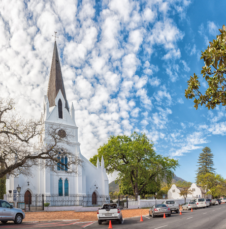 STELLENBOSCH, SOUTH AFRICA, AUGUST 15, 2018: A street scene with the historic Dutch Reformed Mother Church in Stellenbosch in the Western Cape Province. Vehicles are visible Editorial