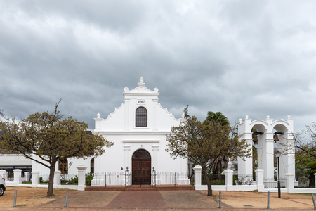 STELLENBOSCH, SOUTH AFRICA, AUGUST 16, 2018: The historic Rhenish Mission Church in Stellenbosch in the Western Cape Province. A belfry with two bells is visible