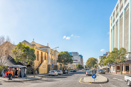 CAPE TOWN, SOUTH AFRICA, AUGUST 17, 2018: A view of Bree Street in Cape Town. The Love Thy Neighbour Restaurant, in an historic church, people and vehicles are visible Editorial