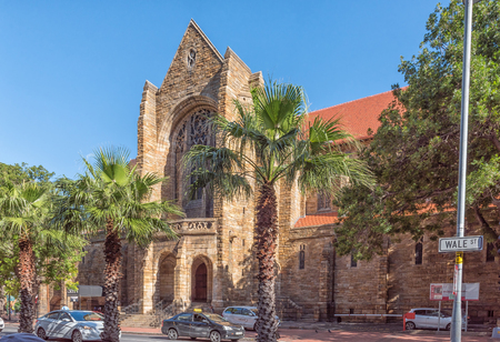 CAPE TOWN, SOUTH AFRICA, AUGUST 17, 2018: A view of Wale Street with the St Georges Cathedral in the back. Vehicles and palm trees are visible