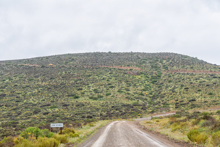Start of the Hoek Se Berg Pass near Mertenhof on the road between Wupperthal and Clanwilliam in the Cederberg Mountains of the Western Cape Province. A truck is visible