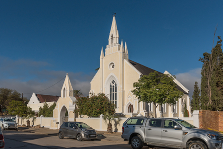 CLANWILLIAM, SOUTH AFRICA, AUGUST 28, 2018: The historic first Dutch Reformed Church in Clanwilliam in the Western Cape Province. Vehicles are visible. Editorial