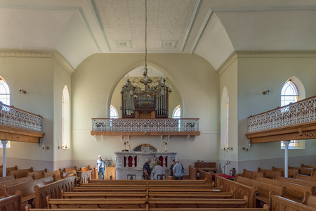 NIEUWOUDTSVILLE, SOUTH AFRICA, AUGUST 29, 2018: Interior of the Dutch Reformed Church in Nieuwoudtville in the Northern Cape Province. People are visible