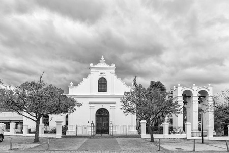 STELLENBOSCH, SOUTH AFRICA, AUGUST 16, 2018: The historic Rhenish Mission Church in Stellenbosch in the Western Cape Province. A belfry with two bells is visible. Monochrome