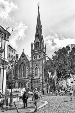CAPE TOWN, SOUTH AFRICA, AUGUST 17, 2018: A view of Greenmarket Square in Cape Town in the Western Cape Province. The Central Methodist Mission Church and people are visible. Monochrome