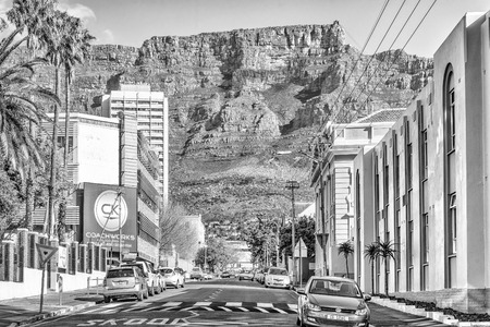 CAPE TOWN, SOUTH AFRICA, AUGUST 17, 2018: A view of Hope Street in Cape Town. Vehicles, Table Mountain and the upper cable station are visible. Monochrome