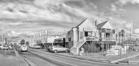 YZERFONTEIN, SOUTH AFRICA, AUGUST 20, 2018: A street scene, with businesses and vehicles, in Yzerfontein on the Atlantic Ocean coast in the Western Cape Province. Monochrome