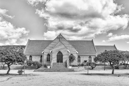 ST HELENA BAY, SOUTH AFRICA, AUGUST 21, 2018: The Dutch Reformed Church in St Helena Bay on the Atlantic Ocean Coast. Monochrome