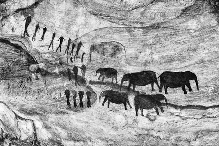 San rock art at the Stadsaal Caves in the Cederberg Mountains in the Western Cape Province. Elephants and people are visible are visible. Monochrome