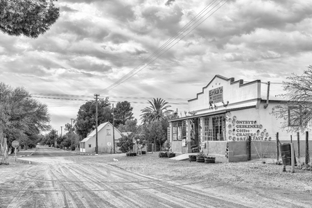 VOSBURG, SOUTH AFRICA, SEPTEMBER 1, 2018: A street scene, with a coffee shop and craft shop, in Vosburg in the Northern Cape Province. Monochrome