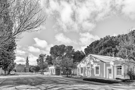 LOXTON, SOUTH AFRICA, AUGUST 7, 2018: A street scene, with the Dutch Reformed Church, in Loxton in the Northern Cape Province. Monochrome Editorial
