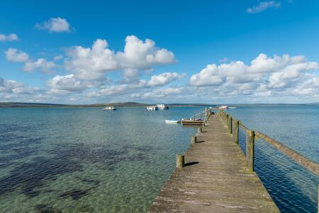 The jetty at Kraalbaai in the Langebaan Lagoon on the Atlantic Ocean. Houseboats are visible