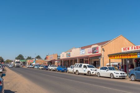 CAROLINA, SOUTH AFRICA - MAY 2, 2019: A street scene, with businesses, vehicles and people, in Carolina, in the Mpumalanga Province