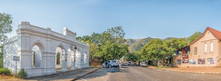 BARBERTON, SOUTH AFRICA - MAY 2, 2019: A street scene, with the entrance to the historic De Kaap Stock Exchange and the Full Gospel Church, in Barberton in the Mpumalanga Province. People and vehicles are visible Redakční