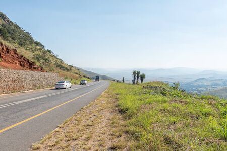 BADPLAAS, SOUTH AFRICA - MAY 2, 2019: A road landscape on the Nelshoogte Pass on road R38 between Badplaas and Barberton in the Mpumalanga Province. Vehicles are visible