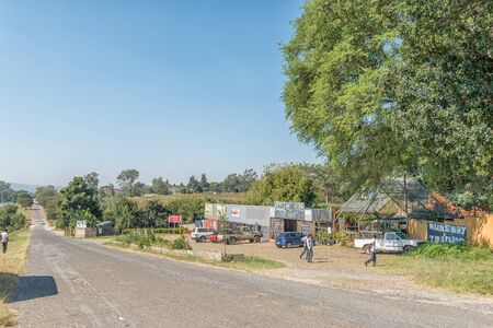 BADPLAAS, SOUTH AFRICA - MAY 2, 2019: A street scene, with businesses, people and vehicles, in Badplaas in the Mpumalanga Province