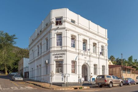 BARBERTON, SOUTH AFRICA - MAY 2, 2019: A street scene, with the historic Lewis and Marks Building and vehicles, in Barberton in the Mpumalanga Province