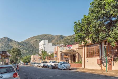 BARBERTON, SOUTH AFRICA - MAY 2, 2019: A street scene, with the Phoenix Hotel, other businesses and vehicles, in Barberton in the Mpumalanga Province
