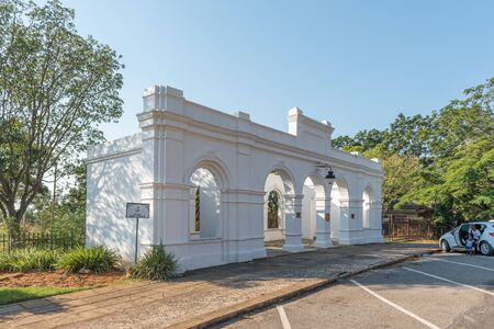 BARBERTON, SOUTH AFRICA - MAY 2, 2019: The entrance to the historic De Kaap Stock Exchange in Barberton in the Mpumalanga Province. People are visible