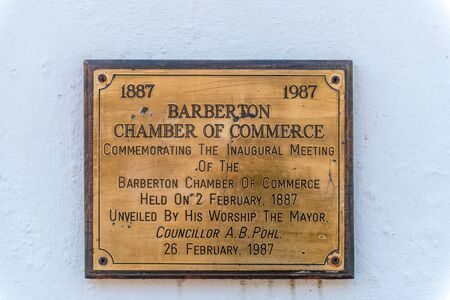 BARBERTON, SOUTH AFRICA - MAY 2, 2019: Memorial plaque at the entrance to the historic De Kaap Stock Exchange in Barberton in the Mpumalanga Province