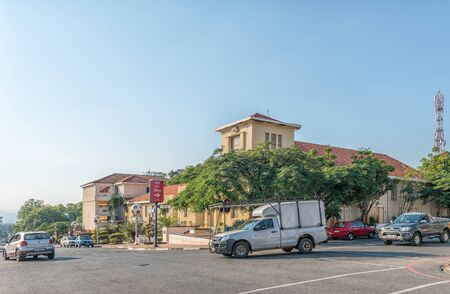 BARBERTON, SOUTH AFRICA - MAY 2, 2019: A street scene, with the municipal offices and vehicles, in Barberton in the Mpumalanga Province