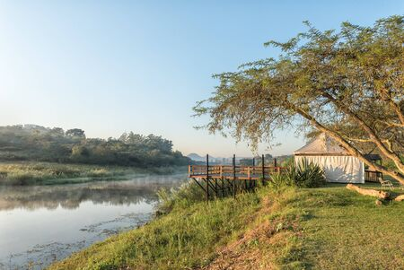 NELSPRUIT, SOUTH AFRICA - MAY 3, 2019: A viewing platform, lapa and lake at the Lakeview Lodge and Caravan Park at Nelspruit in the Mpumalanga Province Redakční
