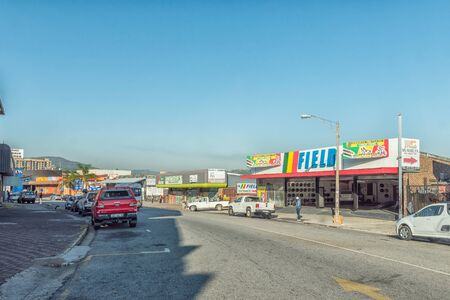 NELSPRUIT, SOUTH AFRICA - MAY 3, 2019: A street scene, with businesses and vehicles, in Nelspruit, in the Mpumalanga Province