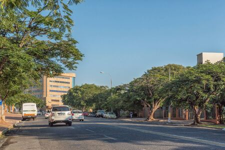 NELSPRUIT, SOUTH AFRICA - MAY 3, 2019: A street scene, with buildings and vehicles, in Nelspruit, in the Mpumalanga Province