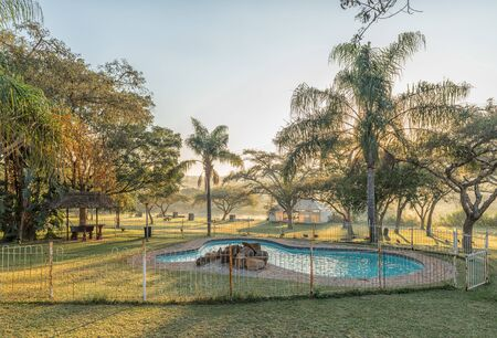 NELSPRUIT, SOUTH AFRICA - MAY 3, 2019: A swimming pool and lapa at the Lakeview Lodge and Caravan Park at Nelspruit in the Mpumalanga Province