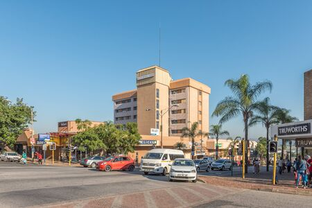 NELSPRUIT, SOUTH AFRICA - MAY 3, 2019: A street scene, with businesses, people and vehicles, in Nelspruit, in the Mpumalanga Province