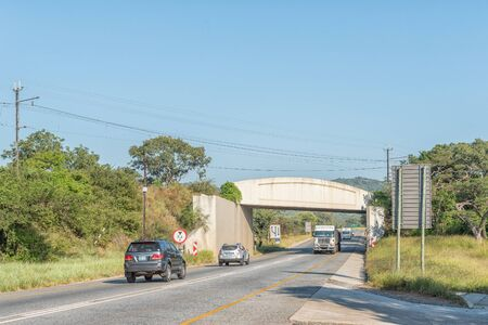 NELSPRUIT, SOUTH AFRICA - MAY 3, 2019: A landscape on road N4 between Nelspruit and Malalane in the Mpumalanga Province. Vehicles and a railroad bridge are visible