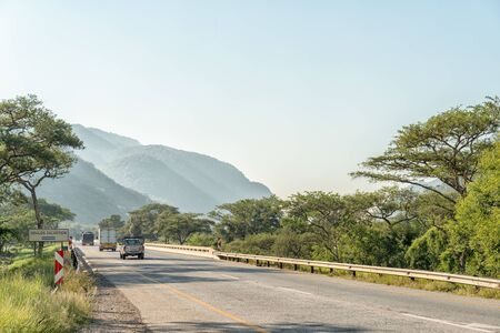 NELSPRUIT, SOUTH AFRICA - MAY 3, 2019: Landscape on road N4 between Nelspruit and Malalane in the Mpumalanga Province. Vehicles and a road bridge are visible Redakční