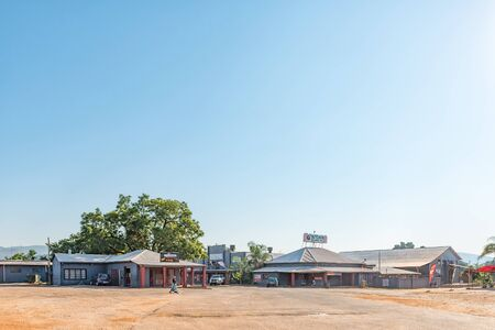 KAAPMUIDEN, SOUTH AFRICA - MAY 3, 2019: A street scene, with businesses, people and vehicles in Kaapmuiden in the Mpumalanga Province Redakční