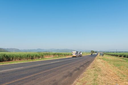 KAAPMUIDEN, SOUTH AFRICA - MAY 3, 2019: Landscape on road N4 near Malalane in the Mpumalanga Province. Vehicles and sugar cane fields are visible Redakční