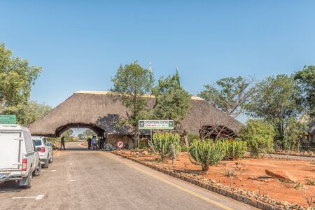 KRUGER NATIONAL PARK, SOUTH AFRICA - MAY 3, 2019: The Malelane entrance gate to the Kruger National Park. Vehicles and people are visible Redakční