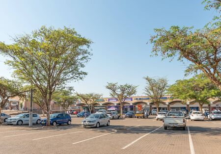 MALELANE, SOUTH AFRICA - MAY 3, 2019: A shopping centre in Malelane in the Mpumalanga Province. People and vehicles are visible