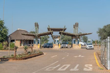 KRUGER NATIONAL PARK, SOUTH AFRICA - MAY 4, 2019: The Kruger National Park entrance gate at the Crocodile Bridge Rest Camp. Vehicles are visible