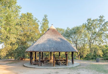 KRUGER NATIONAL PARK, SOUTH AFRICA - MAY 4, 2019: Picnic area at the Afsaal Picnic Site in the Kruger National Park. Tables and benches are visible Redakční