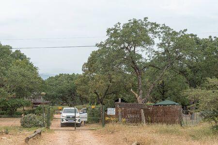 KRUGER NATIONAL PARK, SOUTH AFRICA - MAY 5, 2019: Entrance of the Malelane Bush Camp in the Kruger National Park. A vehicle is visible Redakční
